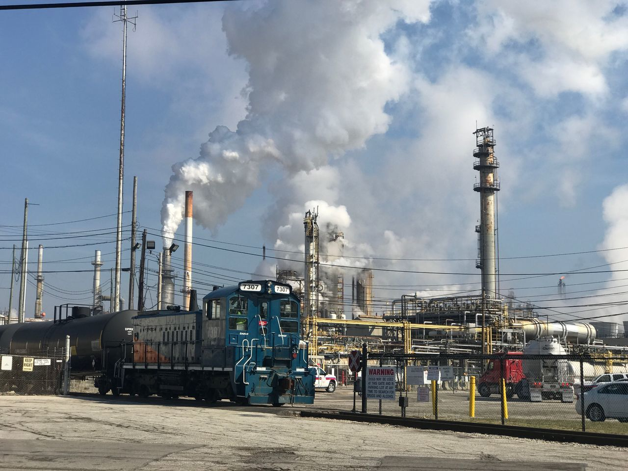 Refinery Train tracks Smoke - Physical Structure Smoke Stack Sky Air Pollution Environmental Issues Outdoors Day Factory Cloud - Sky Industry Emitting No People
