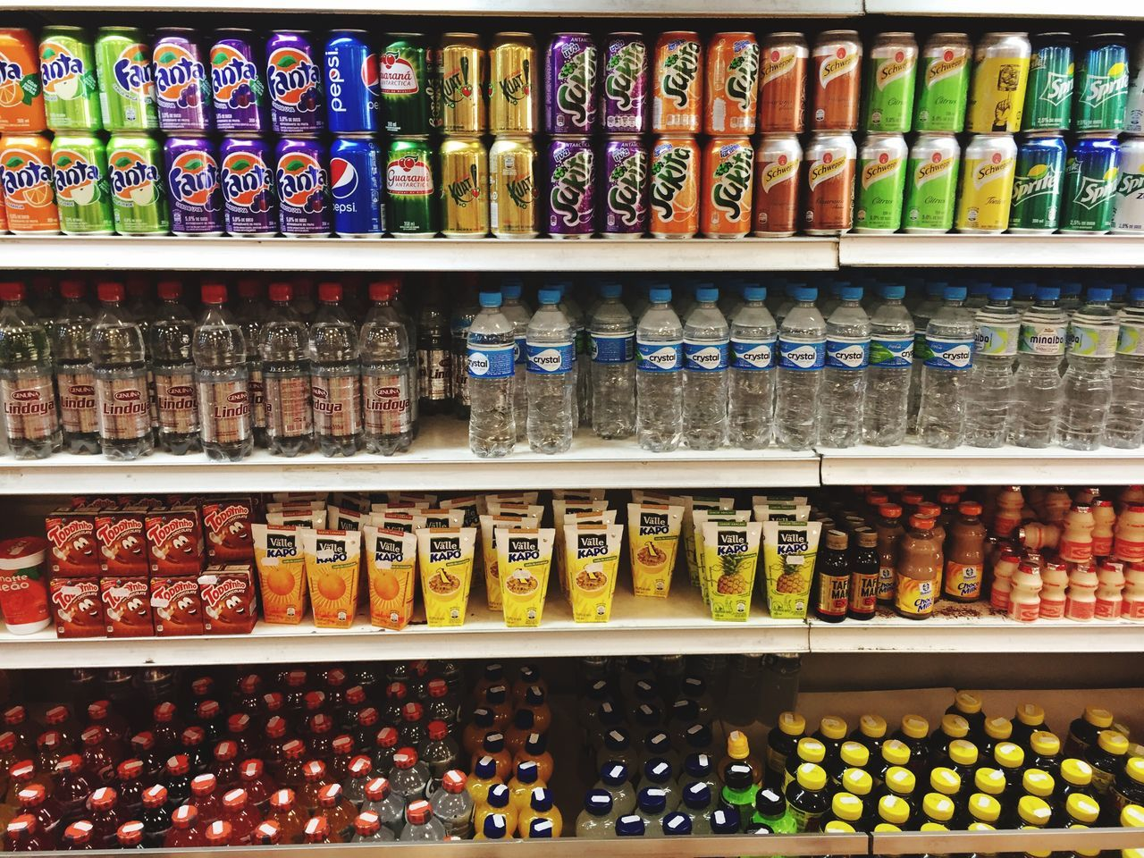 shelf, large group of objects, variation, choice, retail, order, indoors, abundance, multi colored, drink, in a row, arrangement, food and drink, for sale, alcohol, bottle, store, no people, supermarket, food, day, close-up