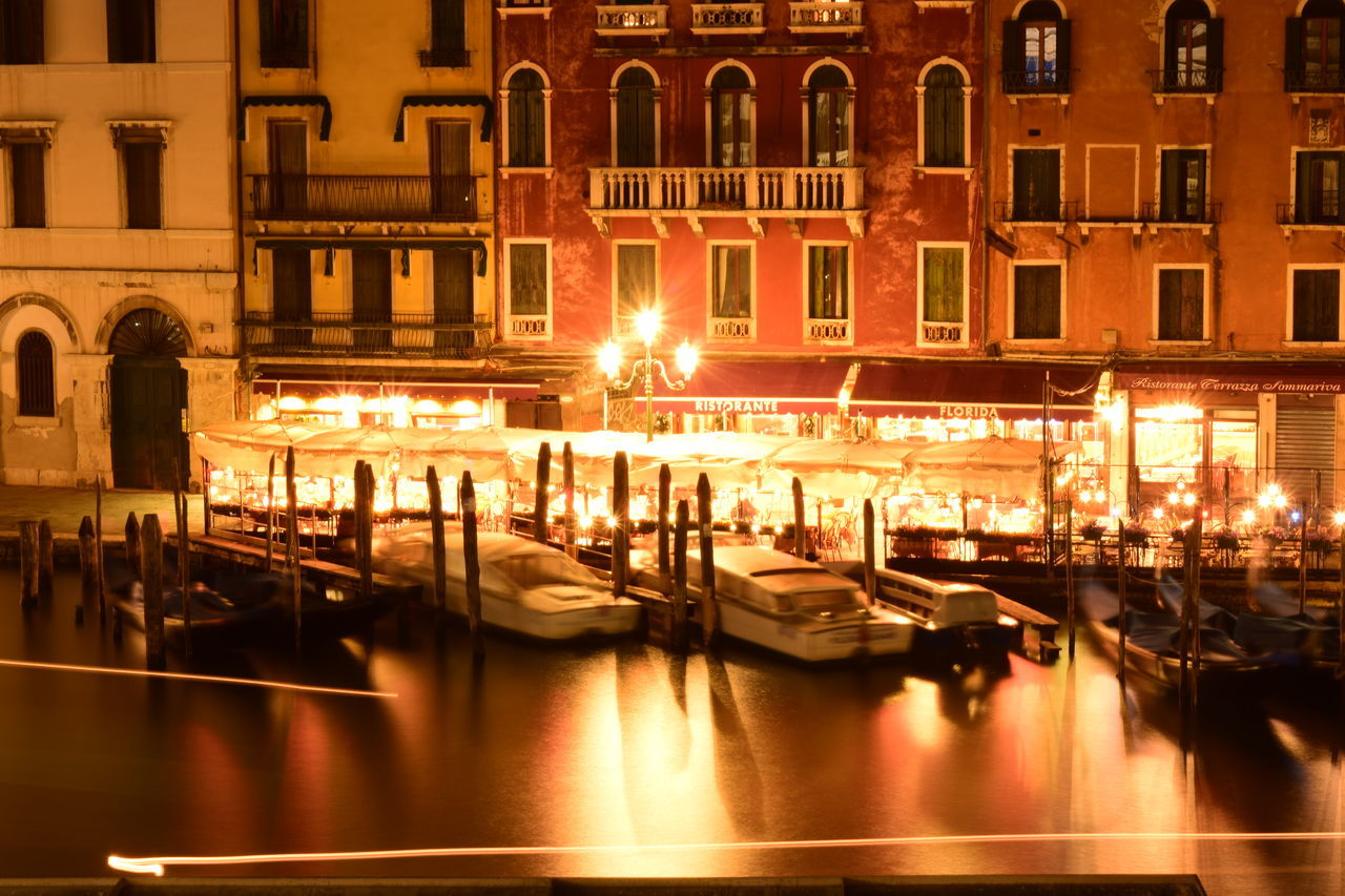 illuminated, night, architecture, building exterior, reflection, built structure, large group of people, nautical vessel, transportation, outdoors, water, real people, city, people
