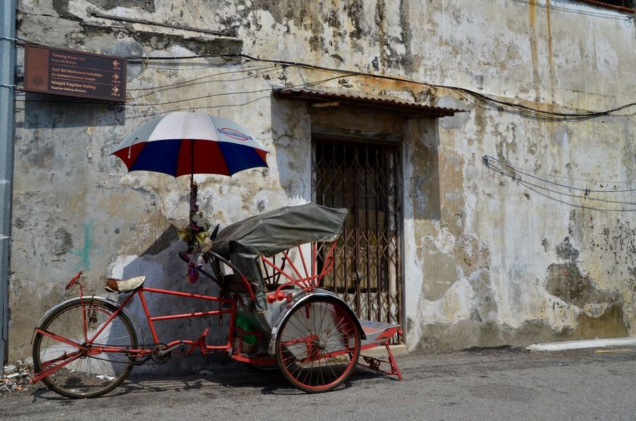Architecture Becak Bicycle Building Exterior Cycling Day Land Vehicle Malaysian Man Made Object Mode Of Transport No People Old Outdoors Parasol Rough Stationary Transportation