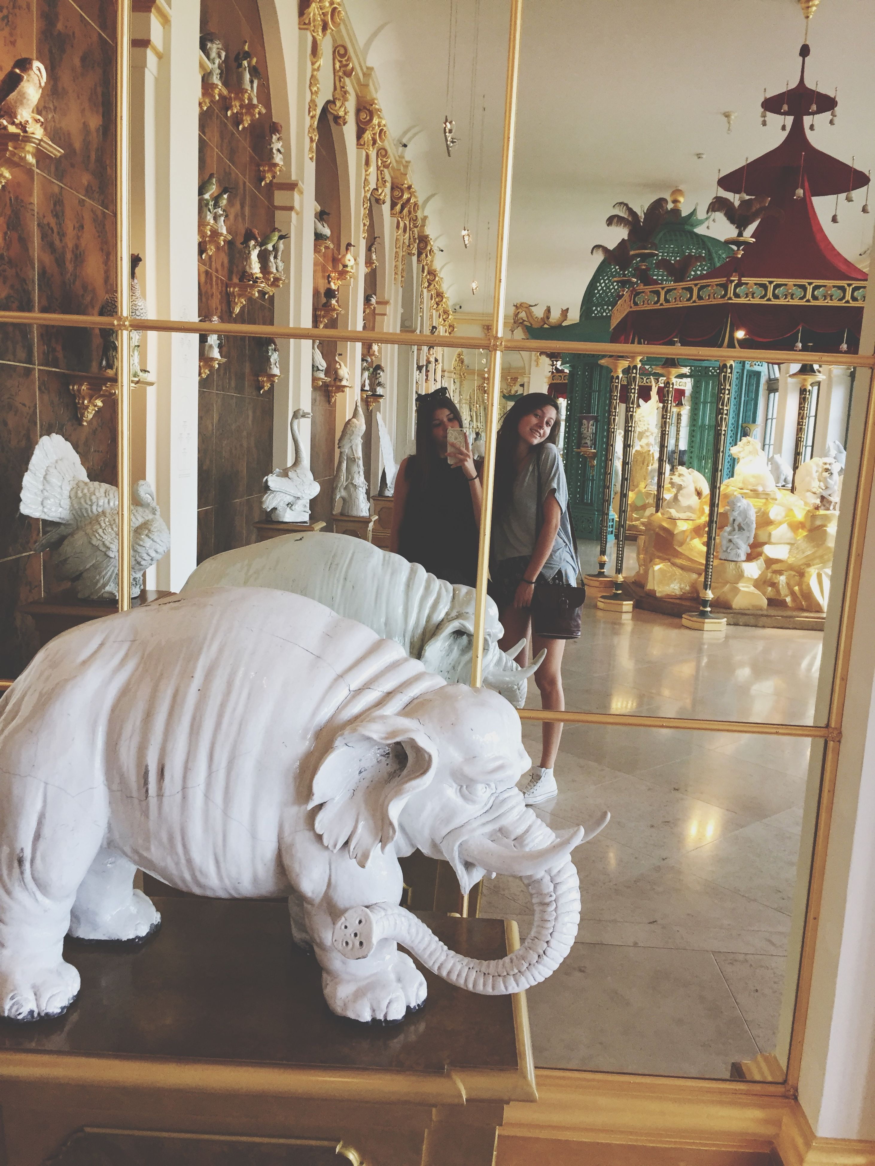 indoors, animal representation, art and craft, art, hanging, human representation, creativity, sculpture, retail, statue, animal themes, bird, decoration, architecture, built structure, glass - material, arts culture and entertainment, no people