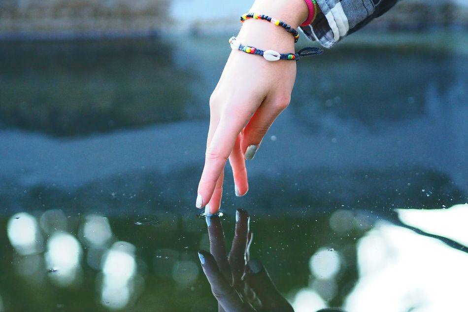 Acariciando el agua One Girl Only Children Only One Person People Child Water Summer Low Section Girls Leg Barefoot Childhood Lake Day Human Body Part Beauty Outdoors Nature Close-up Adult Reflections In The Water Neweyeemhere NewEyeEmPhotographer Freshness Hand