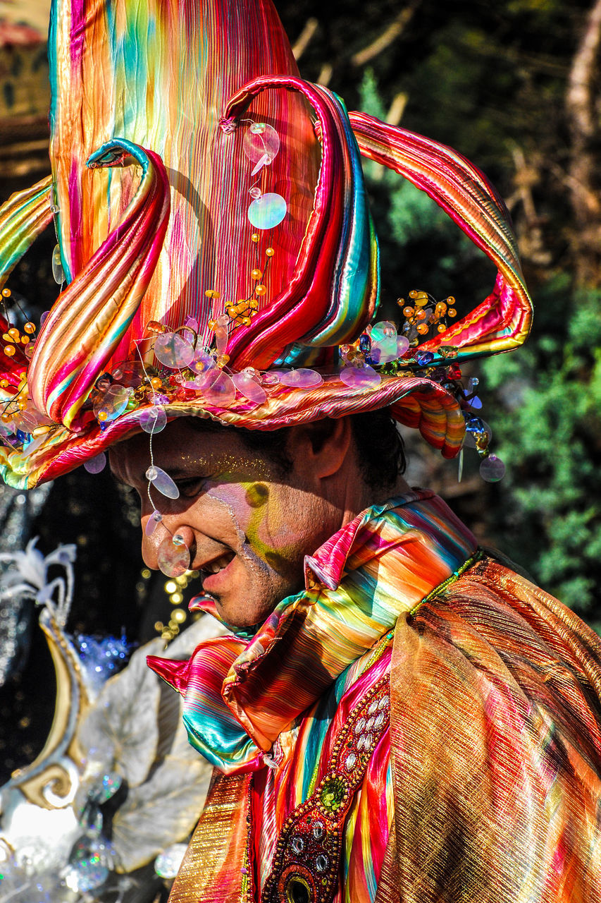 multi colored, tradition, focus on foreground, cultures, outdoors, traditional festival, one person, day, celebration, arts culture and entertainment, real people, adult, close-up, people