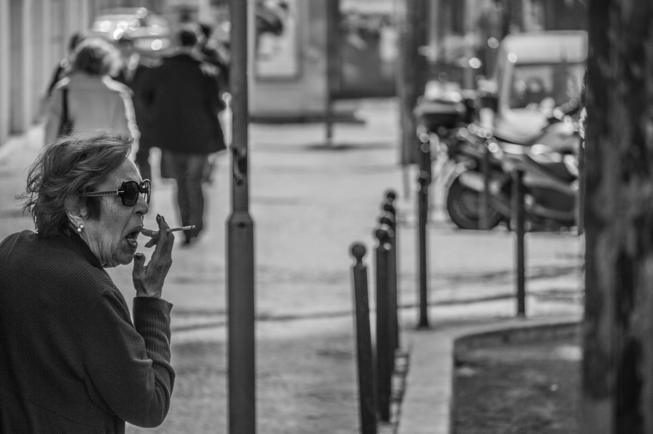 real people, street, focus on foreground, lifestyles, outdoors, day, women, one person, standing, city, young adult, people