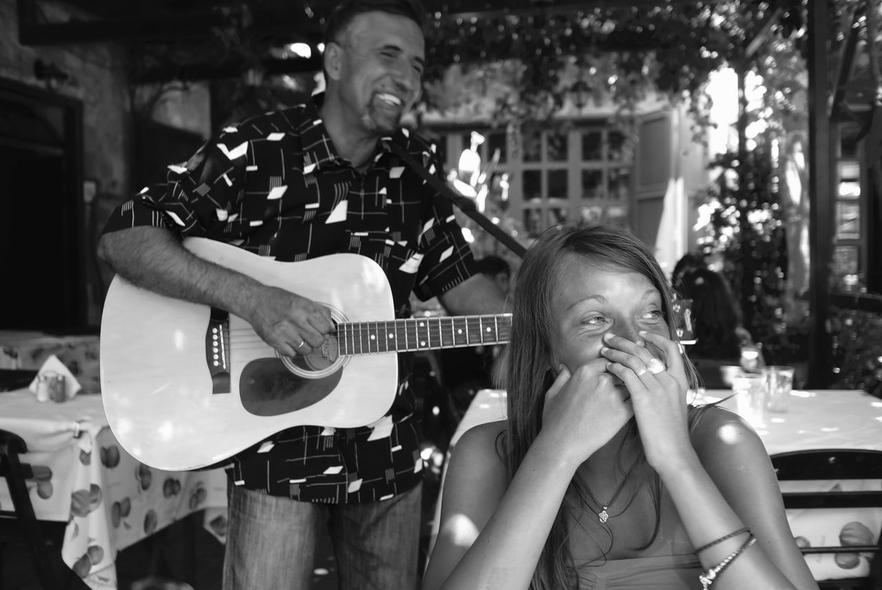 Arts Culture And Entertainment Blackandwhite Photography Cheerful Funny Faces Giggling Guitar Guitarist Leisure Activity Men Music Musical Instrument Performance Playing Two People