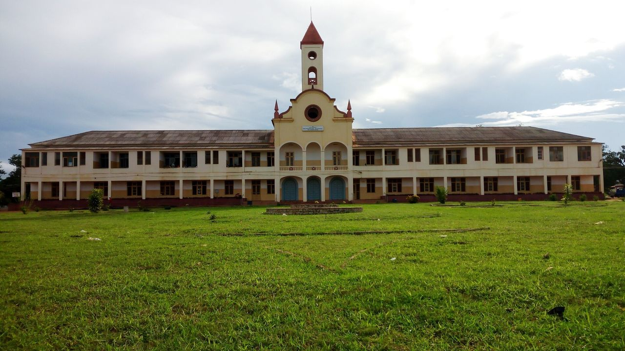 General Hospital Of Marrere, Nampula, MOZAMBIQUE. Constructed by Catholic Christians (Portugueses) a long years ago. The up view it's like a cross. Architecture Building Exterior Grass Cloud - Sky Outdoors Built Structure Day Architecture