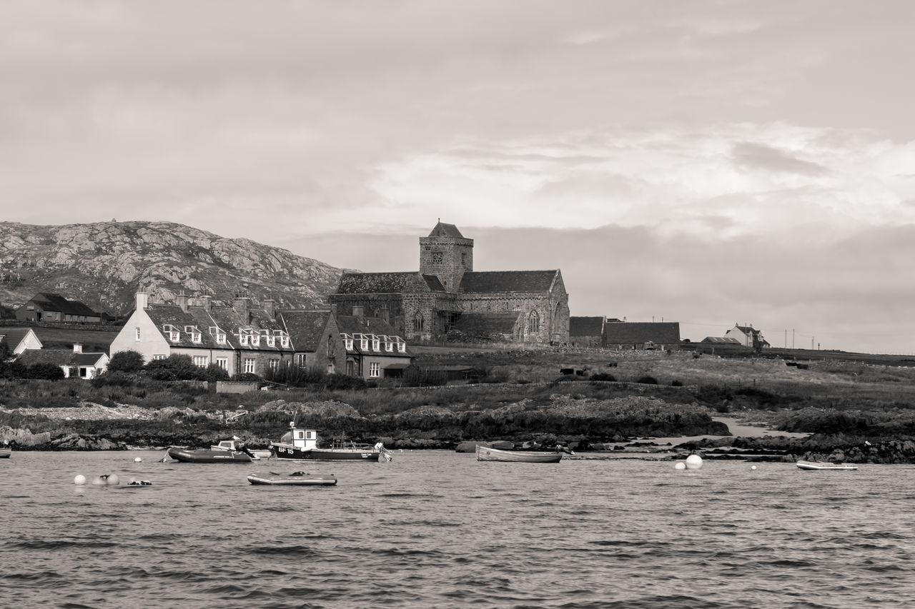 Isle of Mull, Scotland - A religious place on an island, viewed from the opposing shore, black and white Architecture Black & White Blackandwhite Blackandwhite Photography Building Exterior Built Structure Church Cloud - Sky Island Monochrome Outdoor Photography Outdoors Place Of Worship Scenics Scotland Sea Sea And Sky Spirituality Travel Destinations