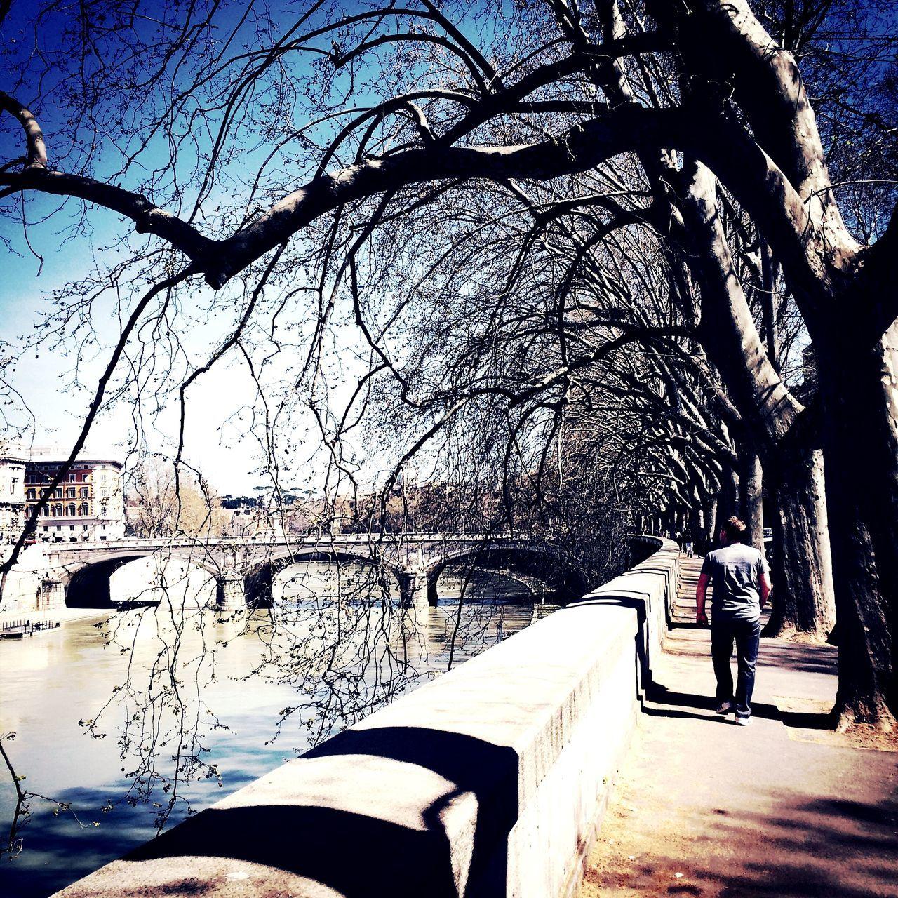 Bridge Over Canal Man Walking Along Retaining Wall