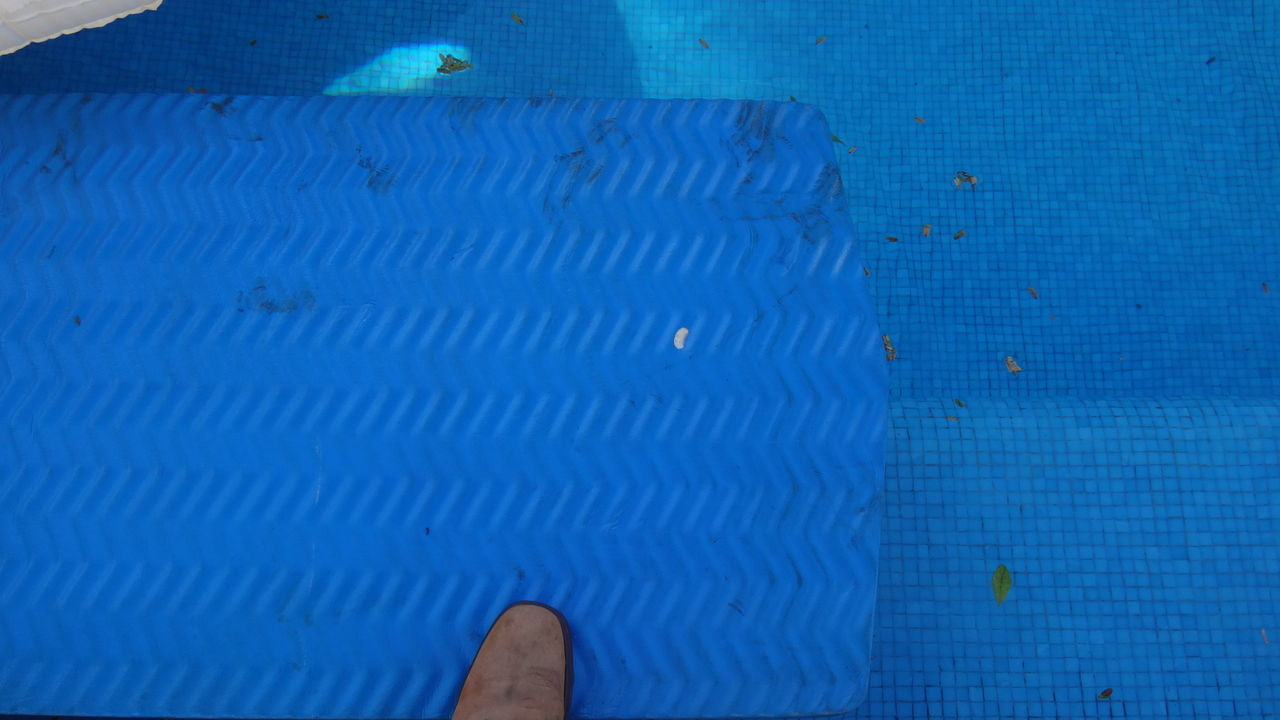 blue, indoors, low section, swimming pool, human body part, close-up, day, one person, people