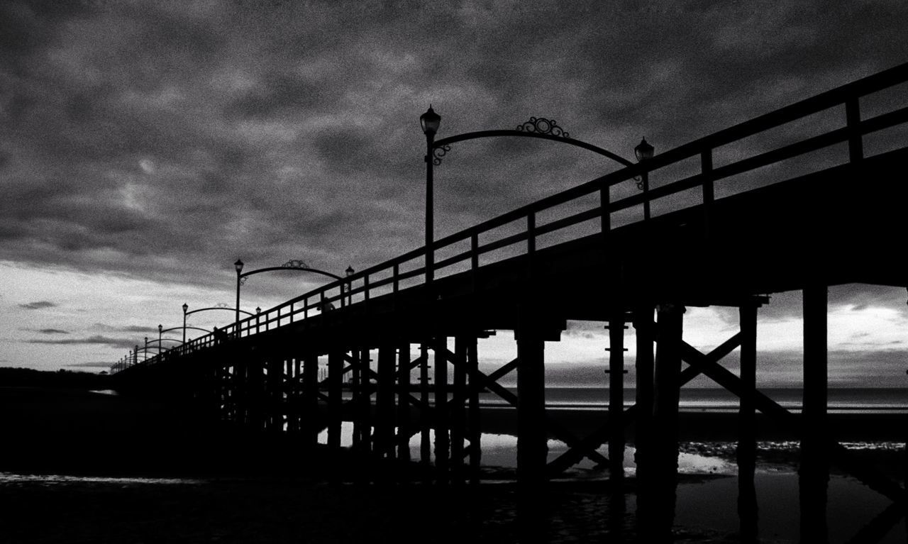 Bridge - Man Made Structure Silhouette Sea Outdoors Water Built Structure Sky No People Day Nature Cityscape Tranquility Nature Horizon Over Water Landscape Beach Night Vacations Branch Harbor Sunset Silhouette Hanging Sunbeam Travel Destinations