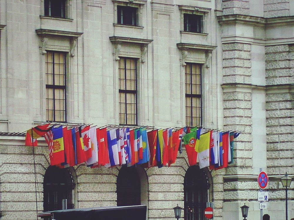 Flags on a Building in Vienna , Austria . Nations Multicultural Countries Different Countries