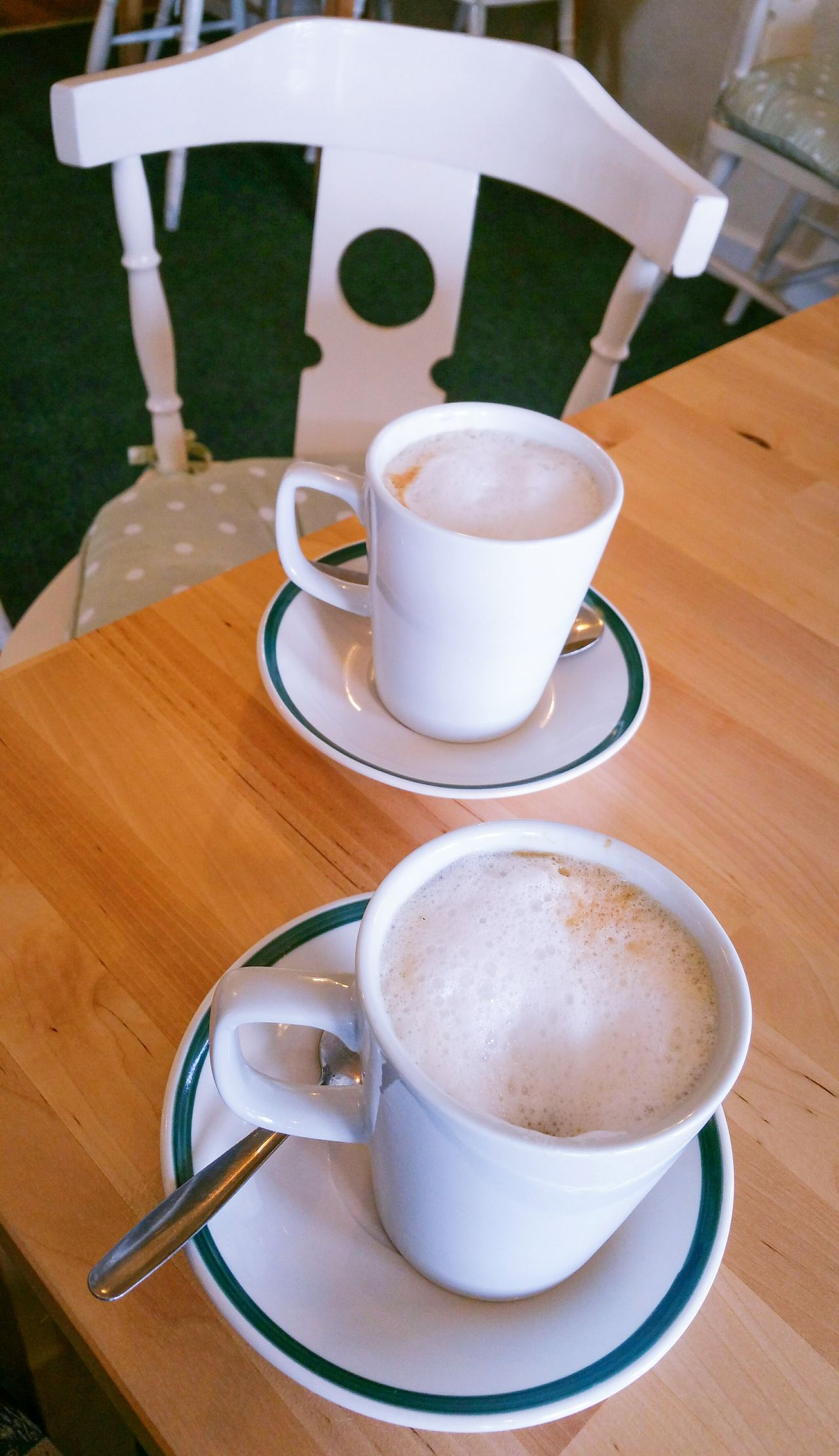 2 Latte Cups in a Caffee Coffee - Drink Coffee Cup Table Drink Saucer Food And Drink High Angle View Refreshment Cappuccino No People Close-up Freshness Indoors  Ready-to-eat Day Chair