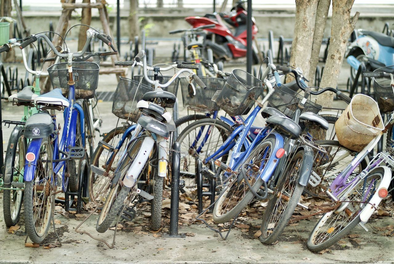 bicycle, transportation, mode of transport, stationary, land vehicle, outdoors, day, bicycle rack, large group of objects, no people, tire, close-up
