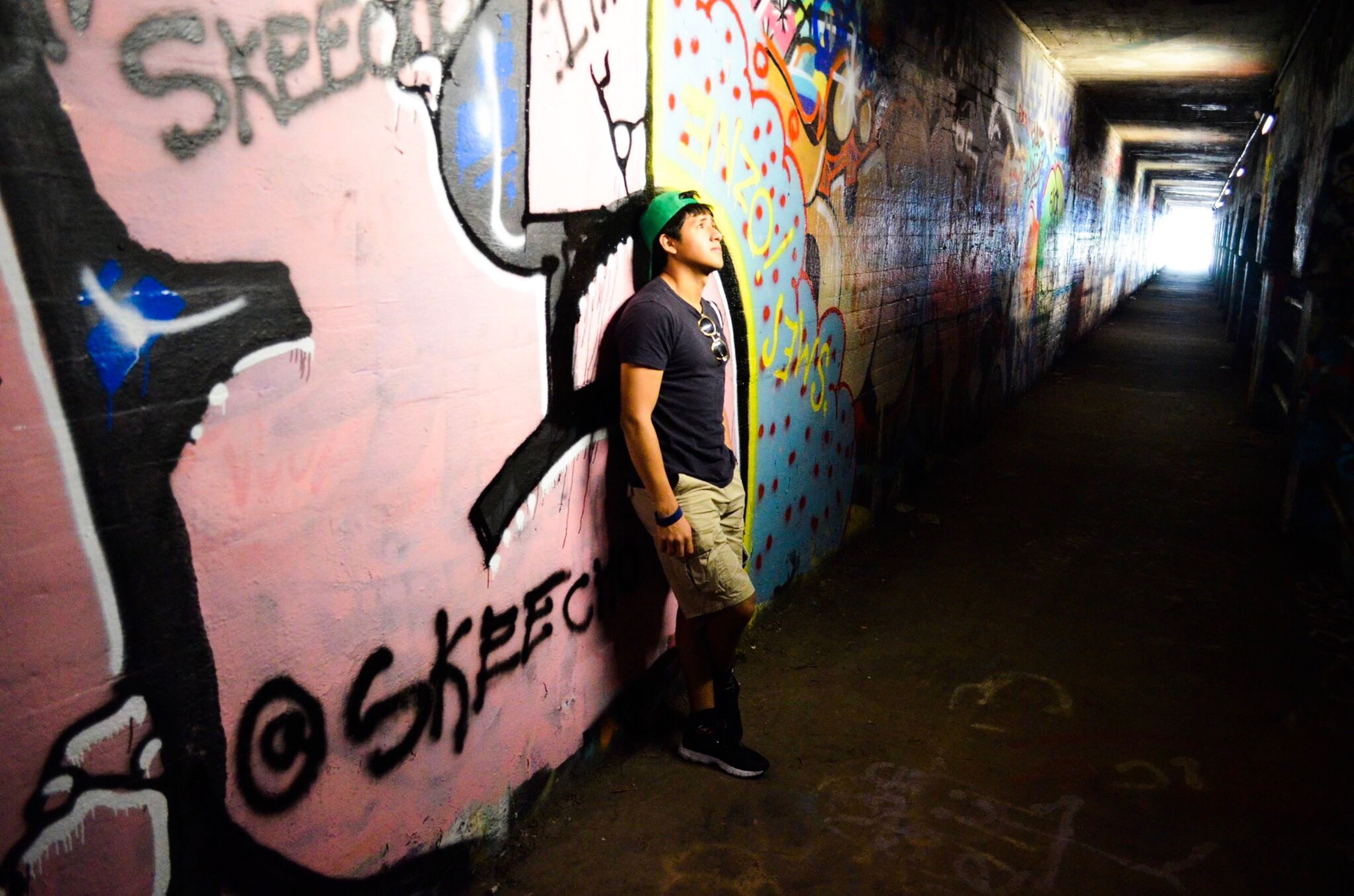 graffiti, one person, real people, night, walking, one woman only, adults only, adult, women, lifestyles, young adult, people, spray paint, outdoors, only women, young women, one young woman only