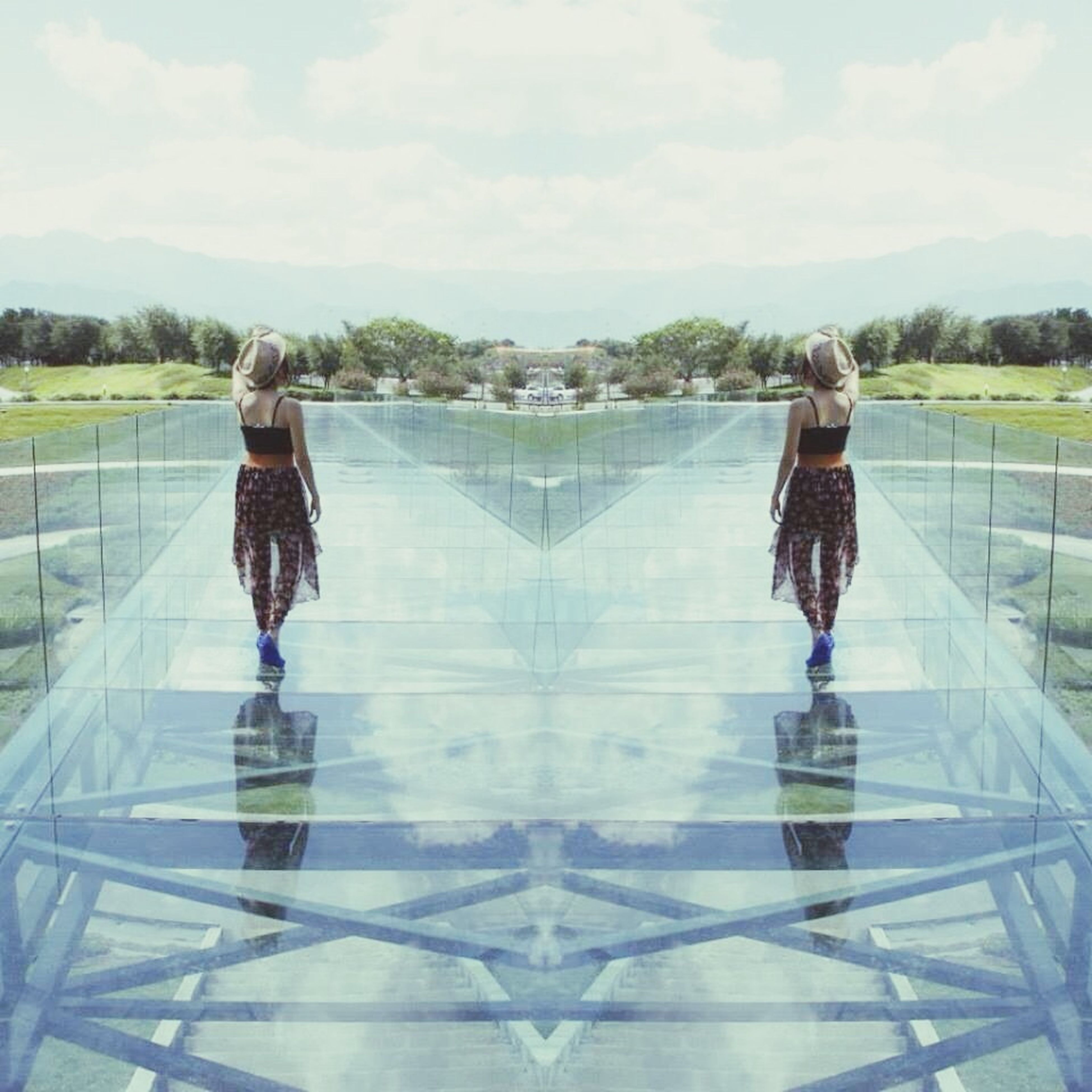 lifestyles, standing, rear view, full length, leisure activity, casual clothing, sky, water, person, cloud - sky, walking, men, railing, day, three quarter length, reflection, nature, tree