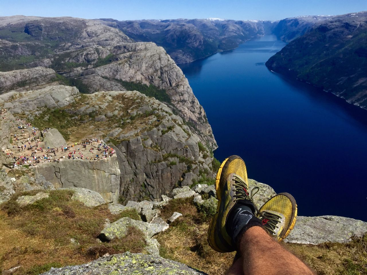 Enjoying the view of the Preikestolen and Lysefjord in Norway 😍 Fjord Water Nature One Person Personal Perspective Exploration Mountain Day Shoe Landscape Cliff Human Leg Adventure Beauty In Nature View Live For The Story The Great Outdoors - 2017 EyeEm Awards The Great Outdoors - 2017 EyeEm Awards Place Of Heart Out Of The Box