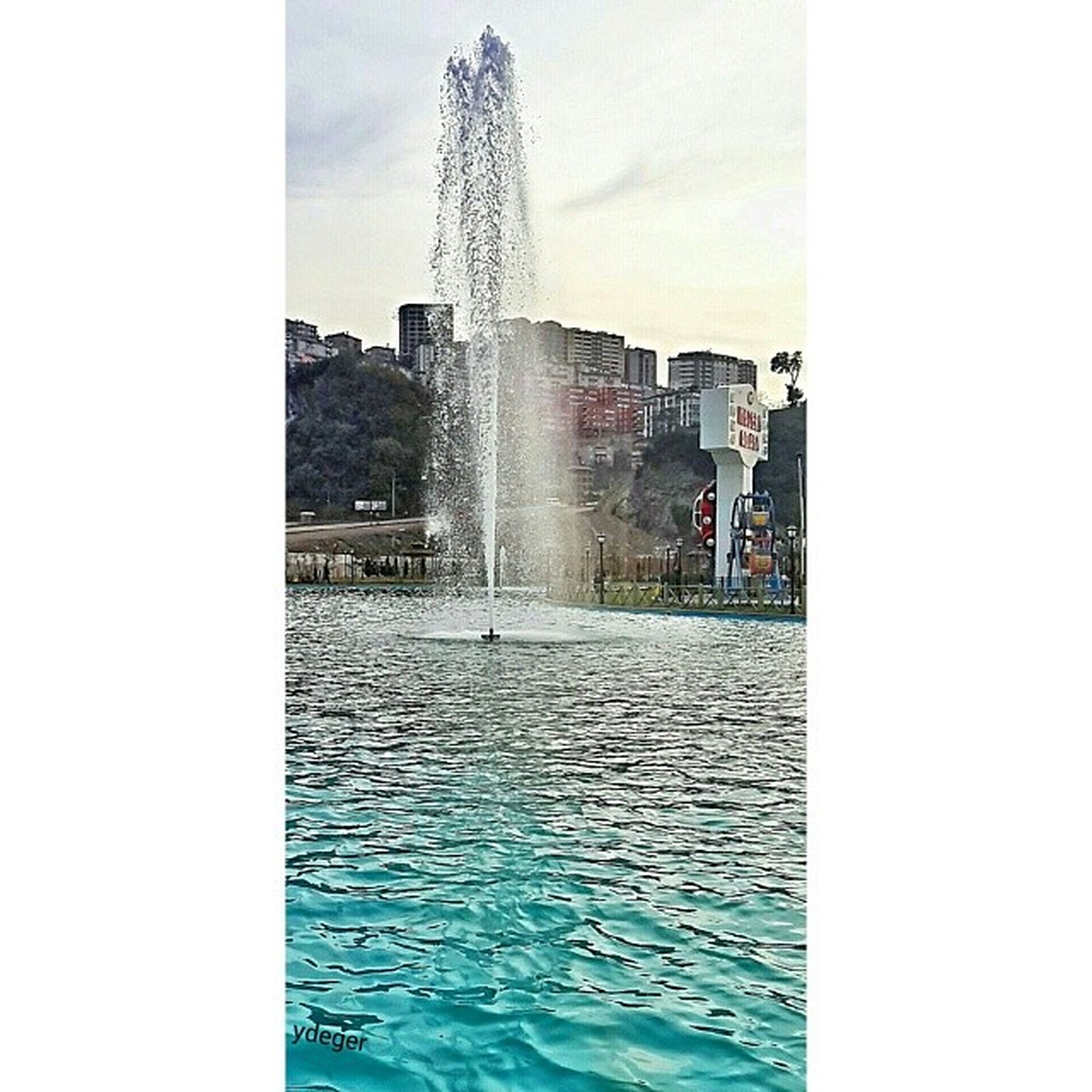 water, architecture, built structure, building exterior, fountain, famous place, waterfront, city, travel destinations, motion, splashing, spraying, international landmark, art and craft, tourism, sky, reflection, transfer print, auto post production filter, capital cities