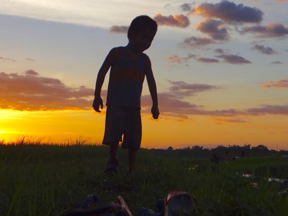 Silhouette of boy Beauty In Nature Boy Clouds And Sky Lifestyles Looking Nature One Boy Only Outdoors Rice Field Rural Scene Scenics Silhouette Sky Standing Sun Sunlight Sunset