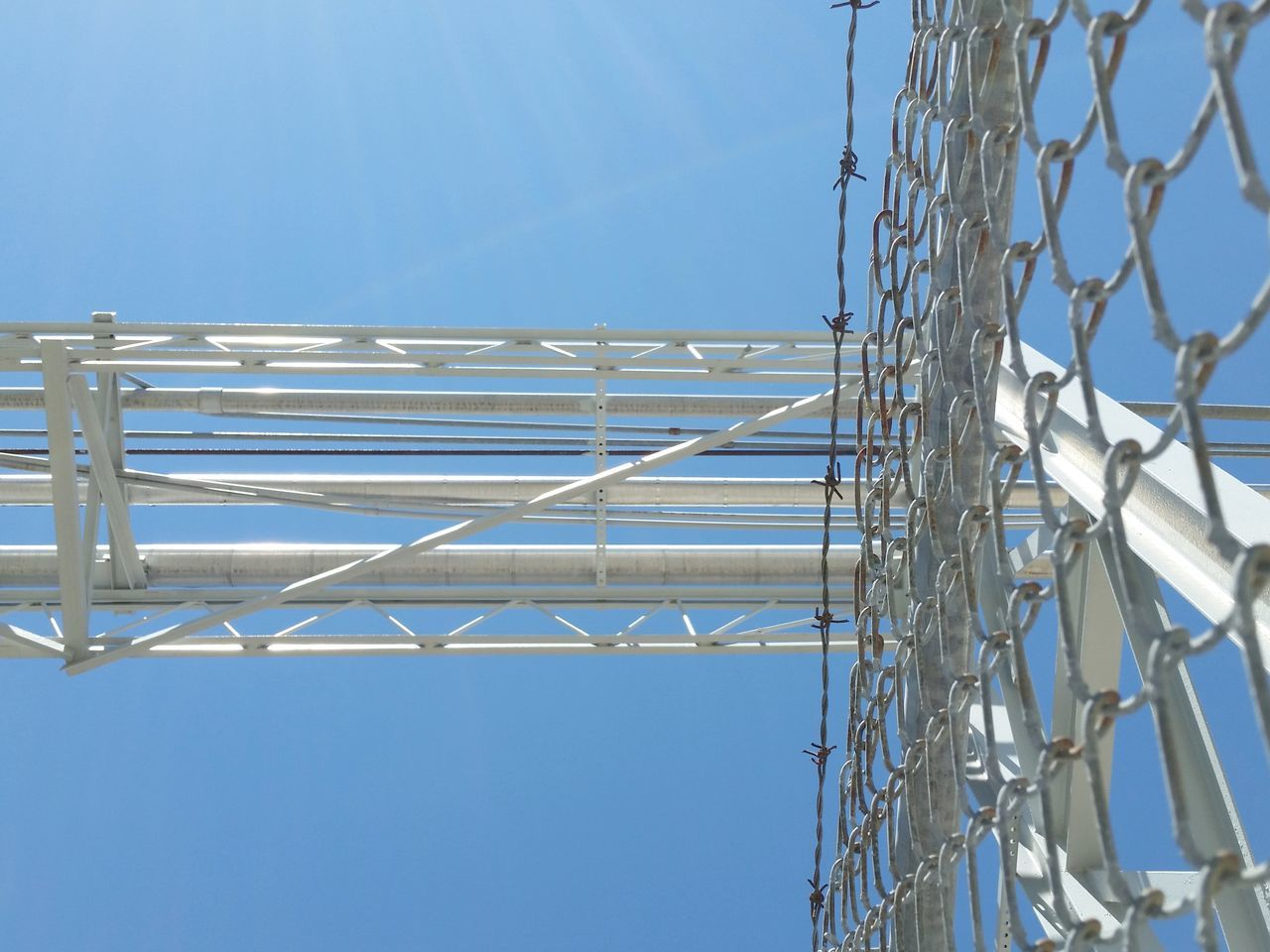 May theme Looking Up Low Angle View Directly Overhead Rails Fence Metal Blue Day Sky Electricity  Clear Sky No People Outdoors Technology Close-up Blue Sky The Architect - 2017 EyeEm Awards