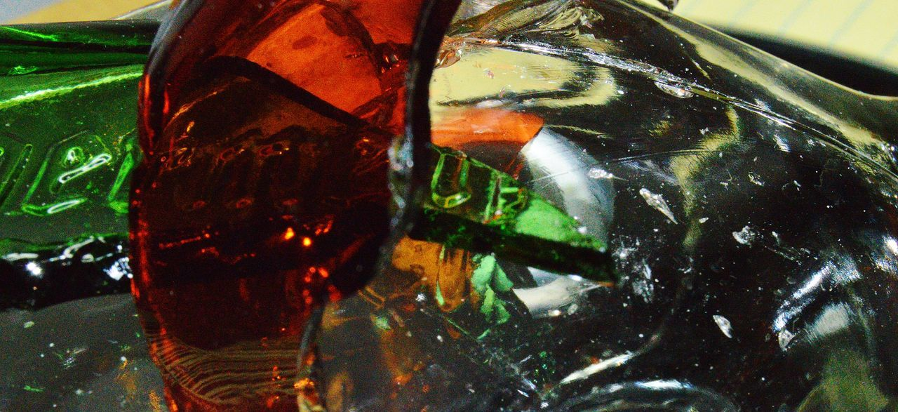 Random glass broken multiple colors and shapes with translucent light Close-up Colors And Shapes In Broken Gla Food And Drink Glass Glass - Material Mixed Random Shapes And Colors No People Red And Green Gla Reflection Translucent Light Transparent Whiskey Bottle