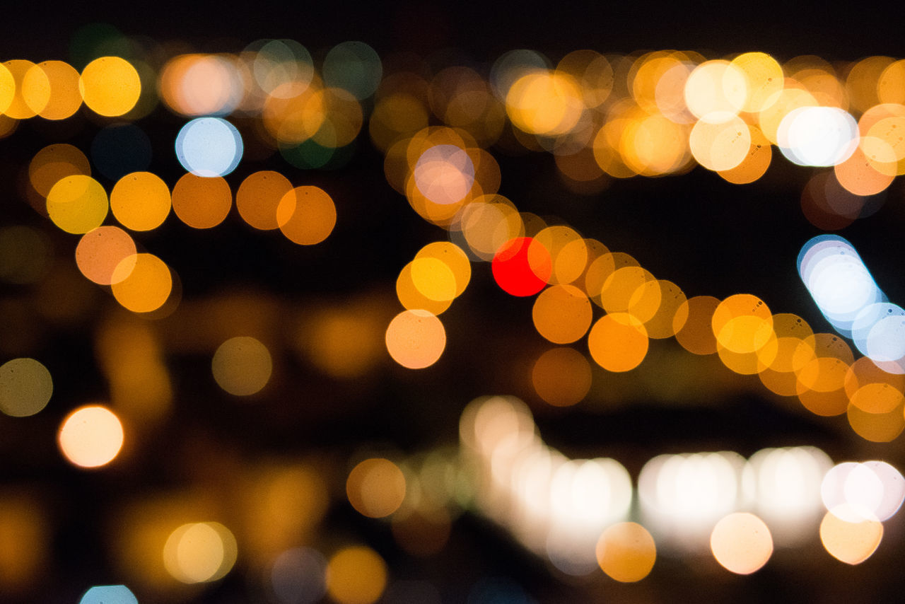 Abstract Bokeh City Close-up Defocused Illuminated Light Effect Lighting Equipment Multi Colored Night Nightlife No People Outdoors Spotted