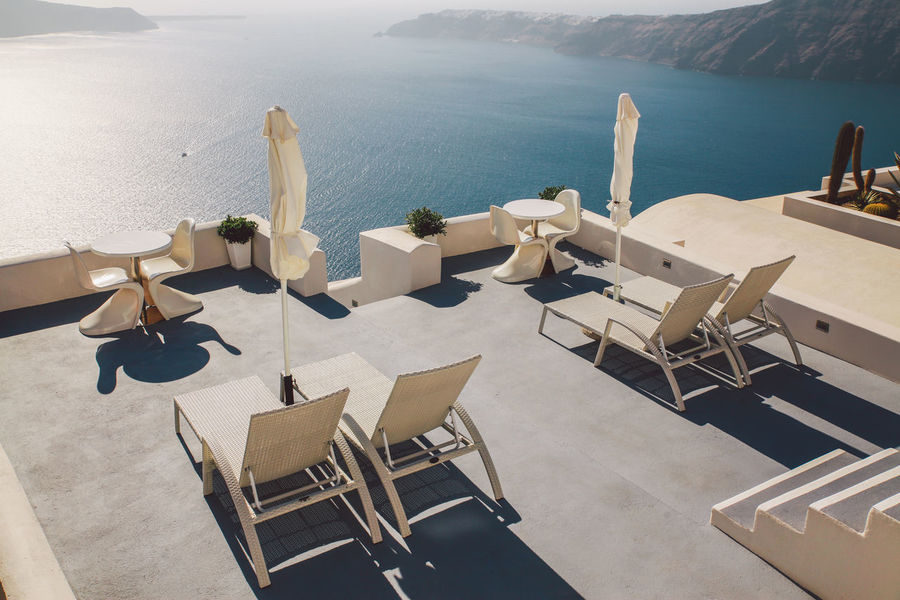 The Essence Of Summer Arrangement Chair Composition Beautifully Organized Empty Human Settlement In A Row Island Large Group Of Objects Perspective Relaxation Santorini Santorini, Greece Sea Seaside Seat Sitting Summer Sunlight Table Vacation Vacations View View From Above Sommergefühle