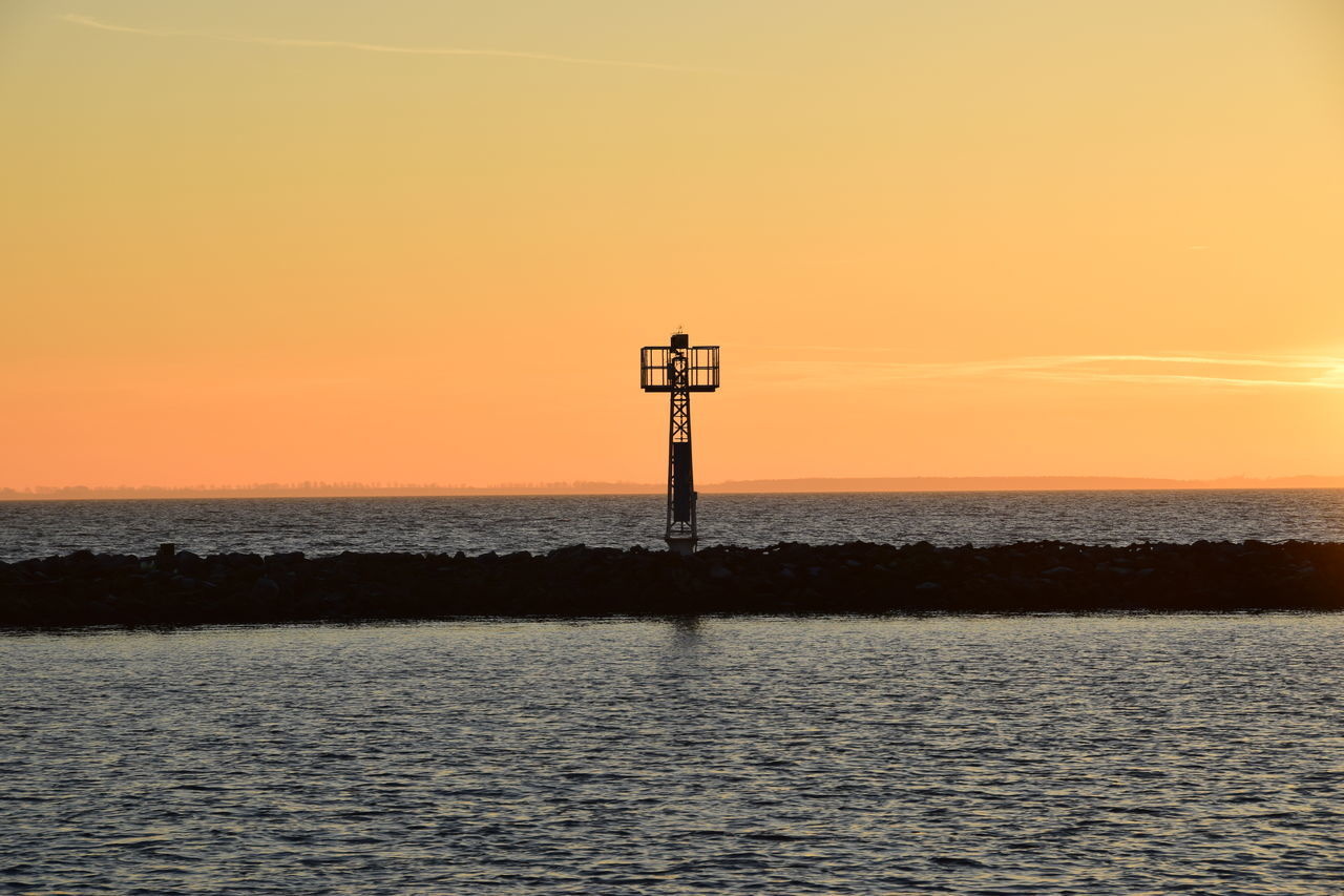 sunset, sea, scenics, horizon over water, tranquil scene, water, beauty in nature, tranquility, nature, silhouette, orange color, idyllic, sky, waterfront, no people, lighthouse, outdoors, travel destinations, day