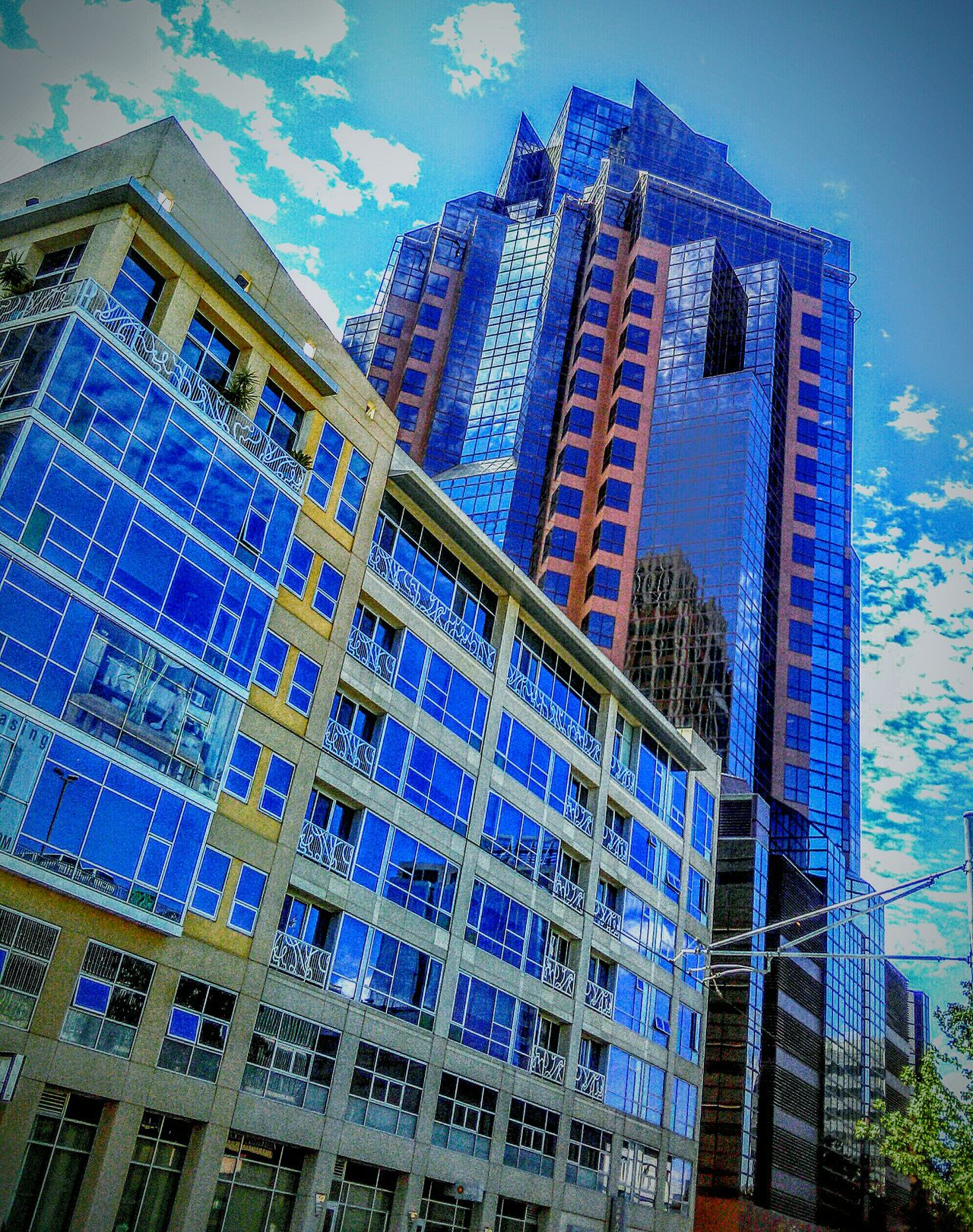 Downtown Sacramento  Street Photography Architecture Photography Reflections Reflections In The Glass Windows Building Photography Eye4photography  Reflection In The Window My Photography Taking Photos ❤ Natural Light Portrait Sky And Clouds