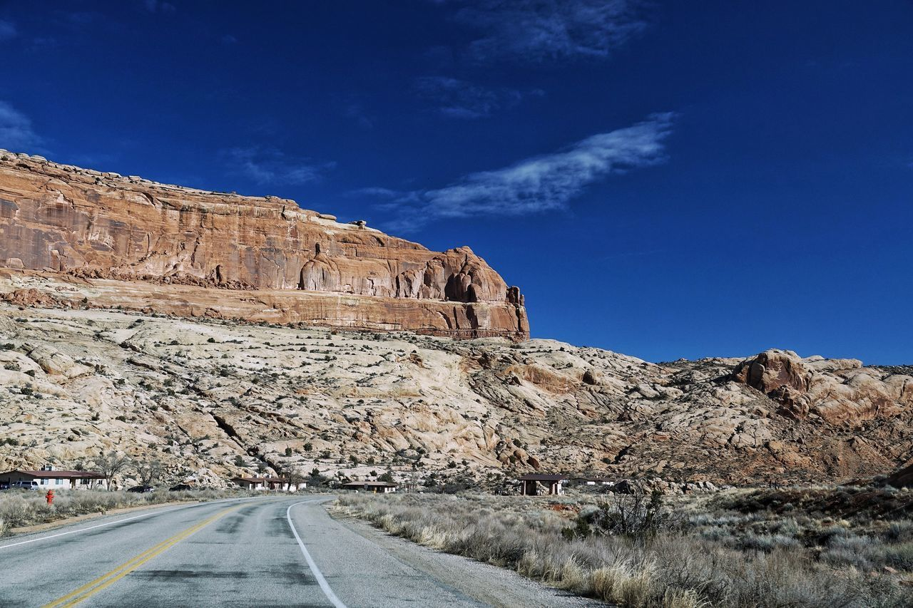 USA Photos Natural Arch Blue Sky Road Outdoors No People Nature Mountain Scenics Landscape Travel Destinations Desert Day Beauty In Nature Clear Sky Beauty In Nature Mountain Range Arid Climate Travel Nature Desert Streamzoofamily