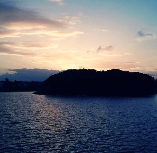 Water Beauty In Nature Scenics Nature Tranquil Scene Tranquility Sunset Silhouette Sea Waterfront No People Sky Rippled Outdoors Mountain Tree Day