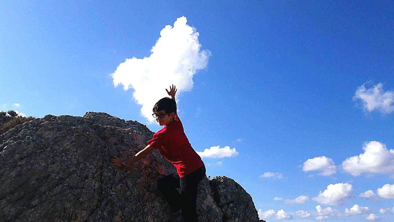 one man only, one person, cloud - sky, sky, only men, adults only, adult, day, outdoors, people, red, low angle view, adventure, men, full length, real people, nature, young adult