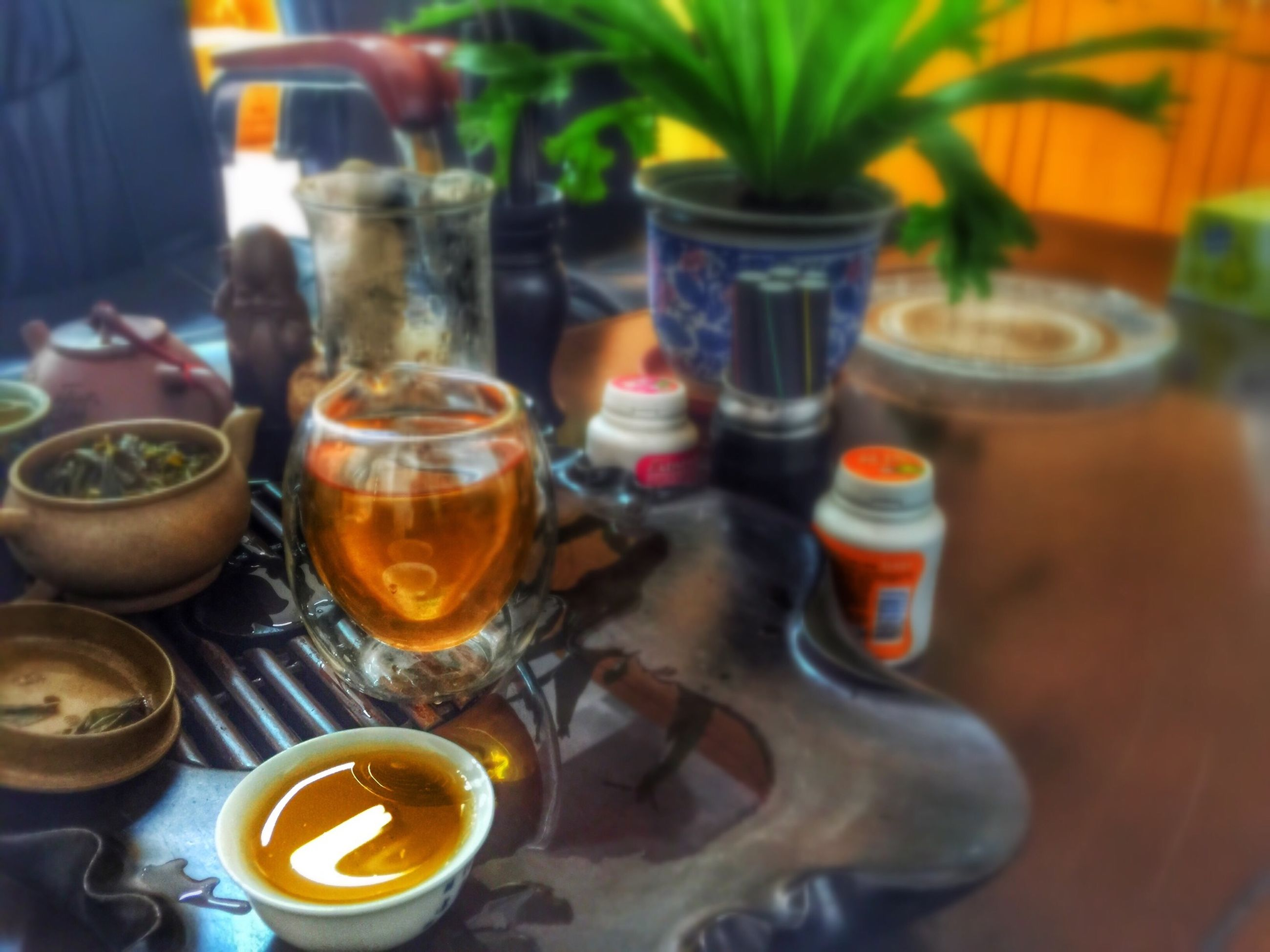 food and drink, drink, indoors, table, refreshment, freshness, still life, drinking glass, close-up, focus on foreground, glass - material, healthy eating, saucer, food, restaurant, coffee cup, coffee - drink, jar, plate, selective focus