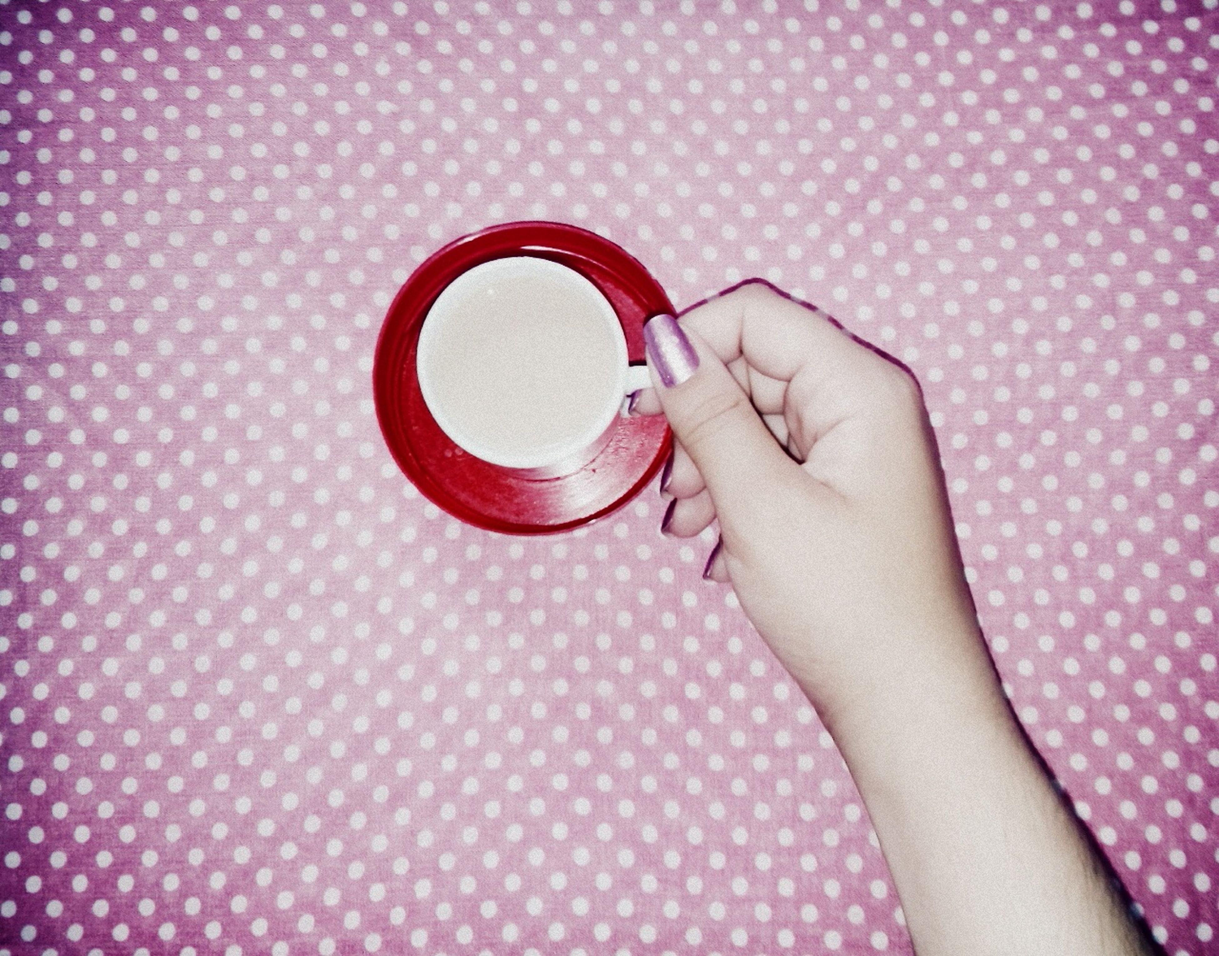 indoors, person, holding, lifestyles, childhood, part of, refreshment, leisure activity, close-up, human finger, high angle view, innocence, drink, coffee cup, cropped, home interior