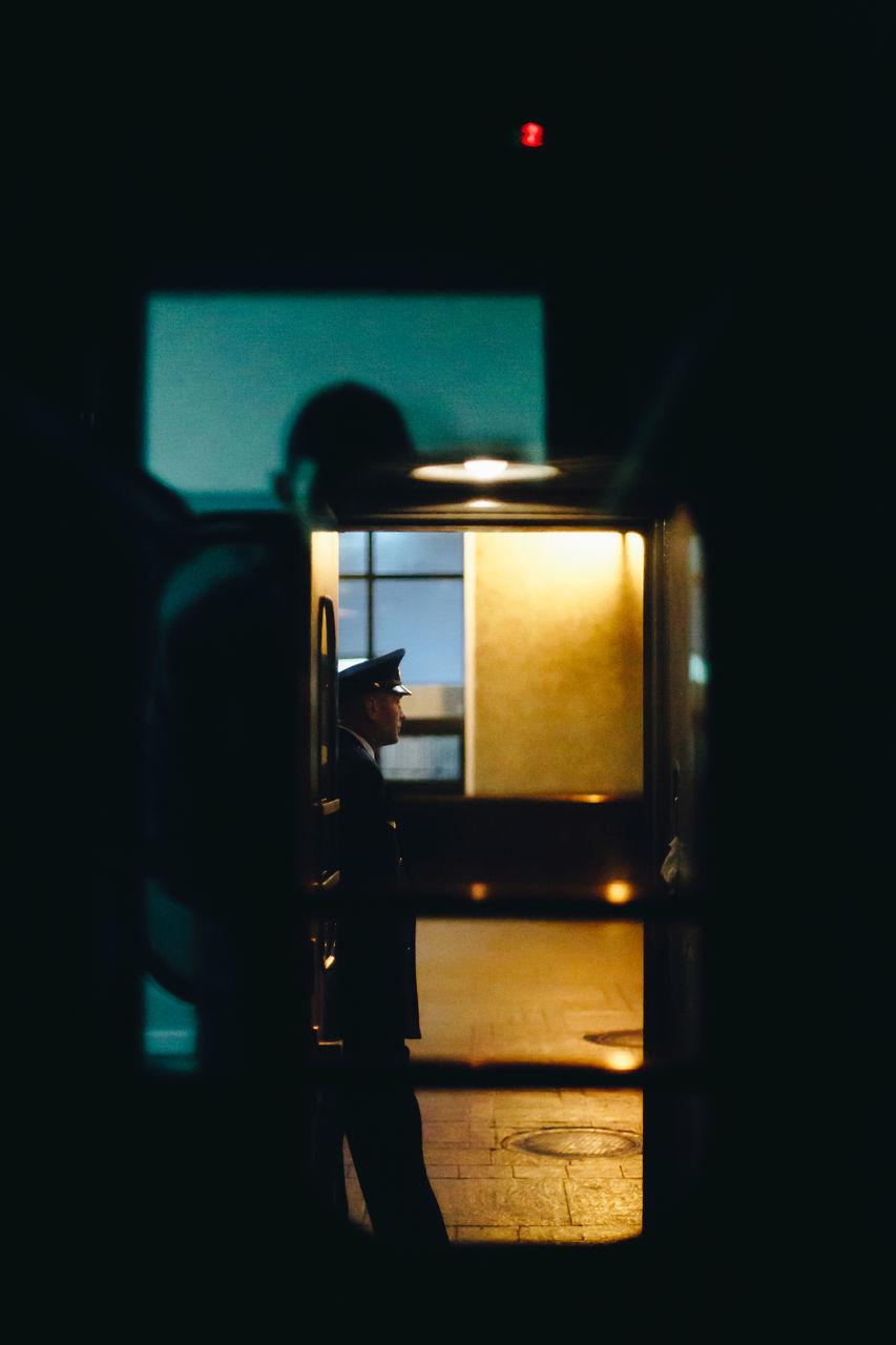 dark, illuminated, night, indoors, men, silhouette, standing, one person, people