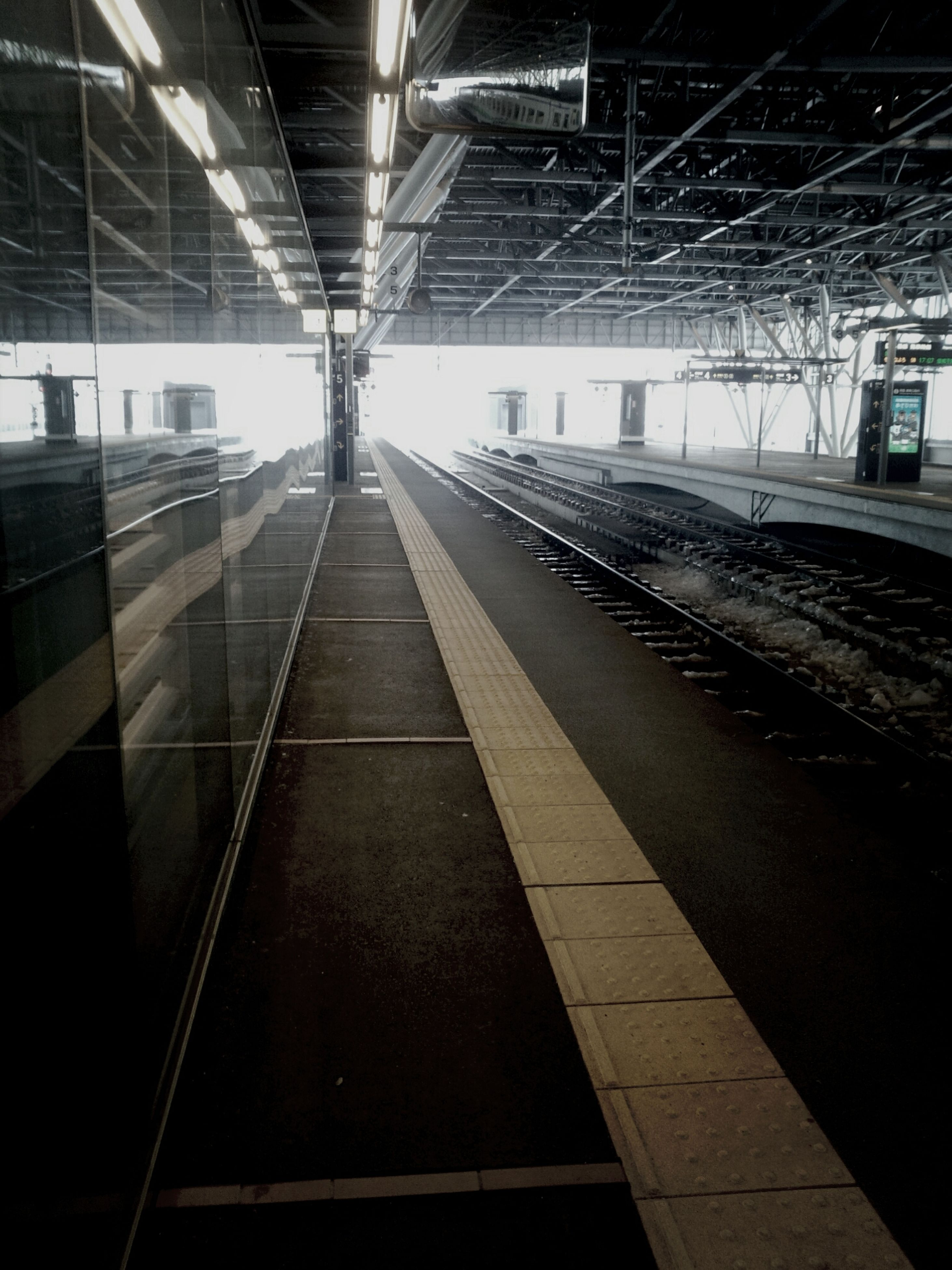 indoors, transportation, railroad track, rail transportation, railroad station, railroad station platform, public transportation, ceiling, built structure, the way forward, architecture, illuminated, diminishing perspective, empty, vanishing point, subway station, interior, travel, transportation building - type of building, subway