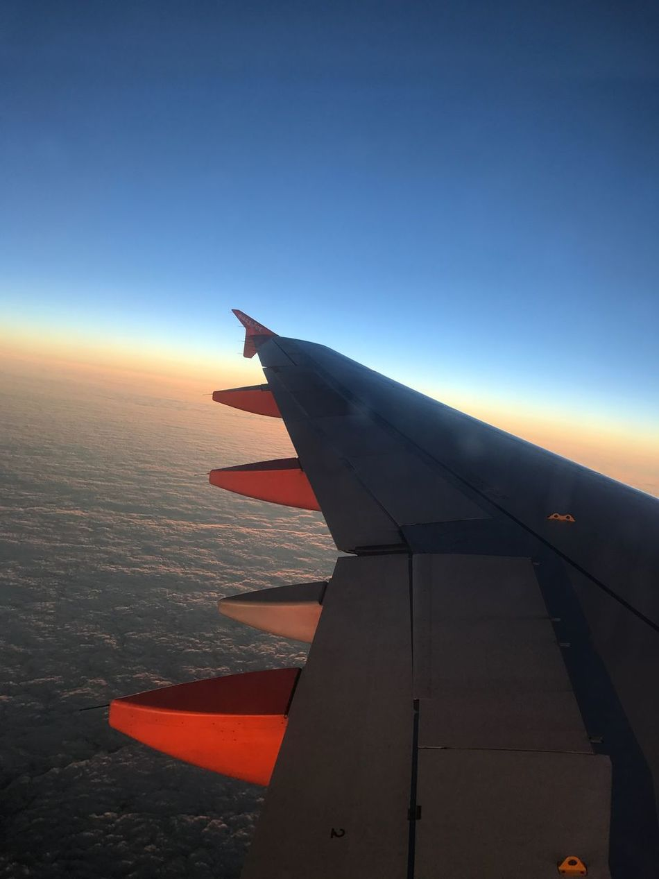 Traveling Home For The Holidays Airplane Travel Transportation Aircraft Wing Sky Flying Mode Of Transport Aerial View Nature Sunlight Airplane Wing Journey No People Clear Sky Outdoors Day Air Vehicle Beauty In Nature