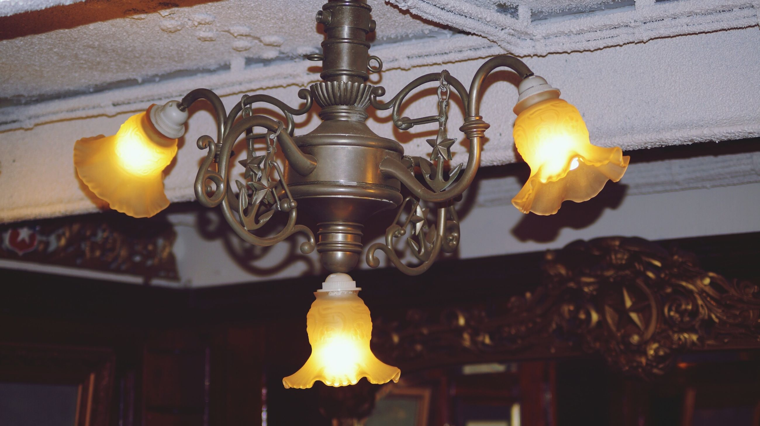 illuminated, indoors, lighting equipment, glowing, electric lamp, hanging, flame, burning, lit, candle, low angle view, light - natural phenomenon, electricity, lantern, electric light, light bulb, lamp, decoration, fire - natural phenomenon, heat - temperature