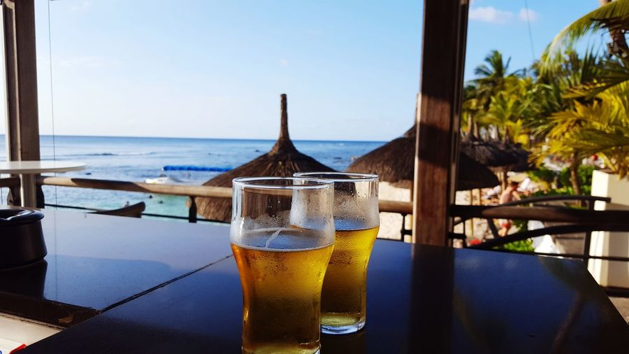 EyeEm Selects mauritius beer cheers beach bar Sea Drink Beach Alcohol Refreshment Clear Sky Vacations
