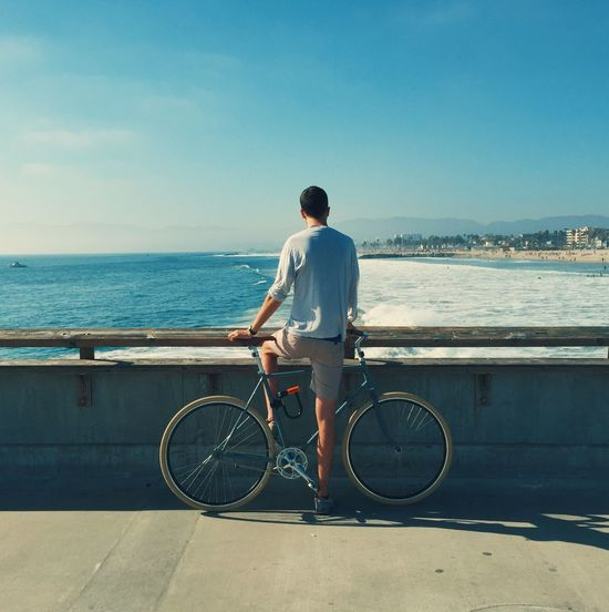 Take a Moment Rear View Full Length Real People Sea Bicycle Lifestyles One Person Water Mode Of Transport Men Transportation Leisure Activity Outdoors Sky Standing Day Nature Horizon Over Water Pier Beach Venice Beach Los Angeles, California
