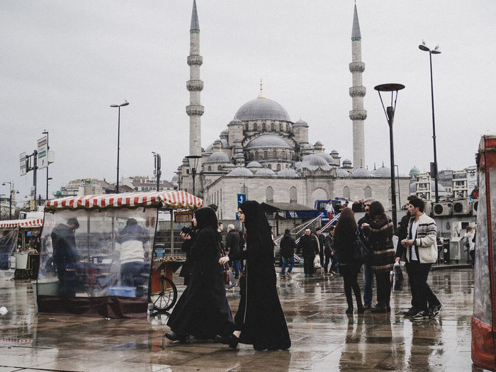 Morning Bustle - Istanbul locals go about their daily routine. At Eminonu, the plaza is filled with boats that sell fish sandwiches, stands that sells corn, nuts, and pretzels, and of course, as rain is commonplace, umbrellas are sold for less than 4 TL. (Photo by Nikki Celis / 2016) Feel The Journey Istanbuldayasam Istanbullovers Traveling Traveldiaries Original Experiences Wanderlust Travel Streetphotography Photojournalism New Talent Morning Adventure TheWeekOnEyeEM New Talent