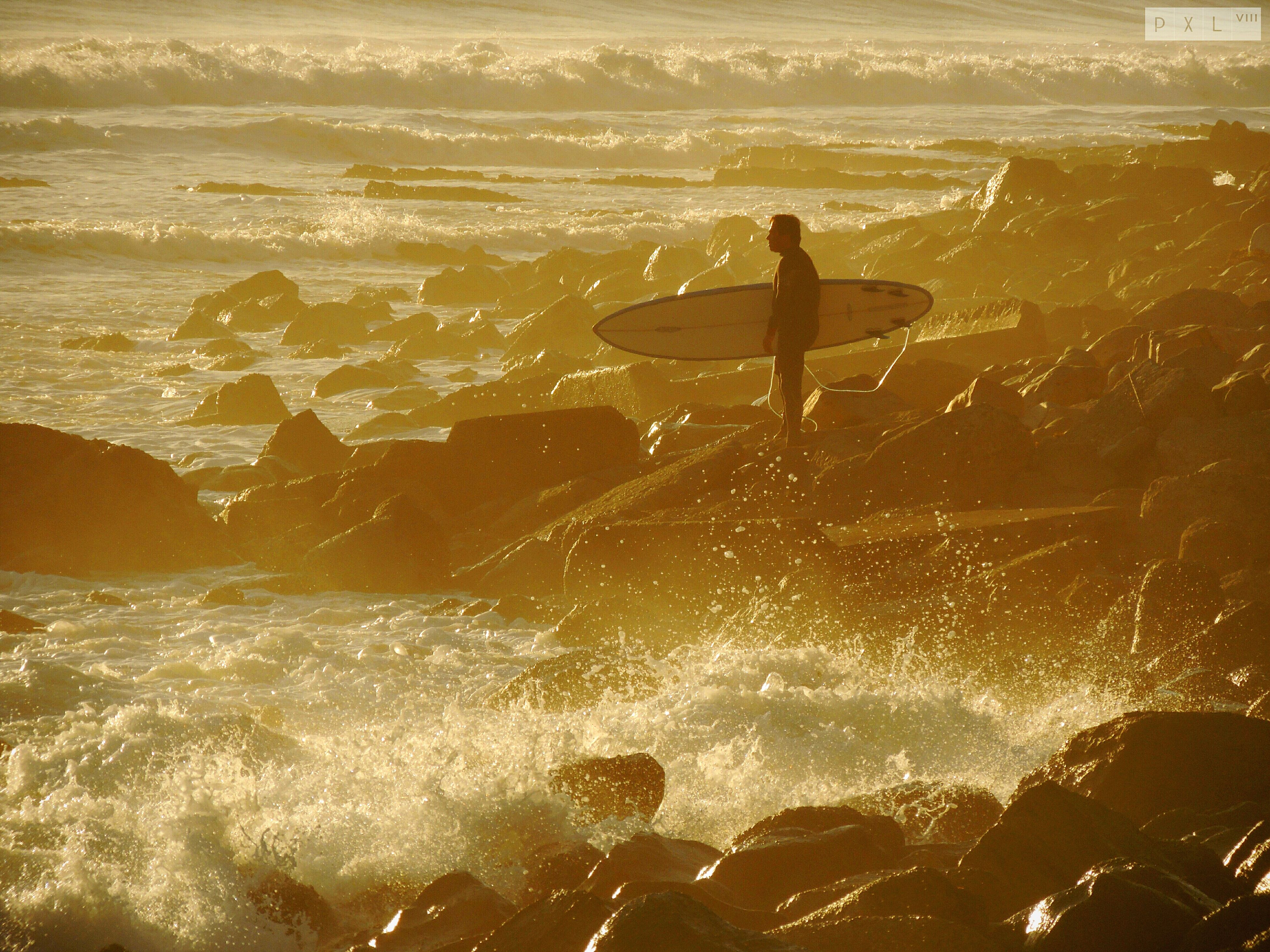 water, sea, leisure activity, lifestyles, wave, beach, men, silhouette, full length, vacations, shore, enjoyment, surf, nature, sunlight, motion, surfboard, beauty in nature