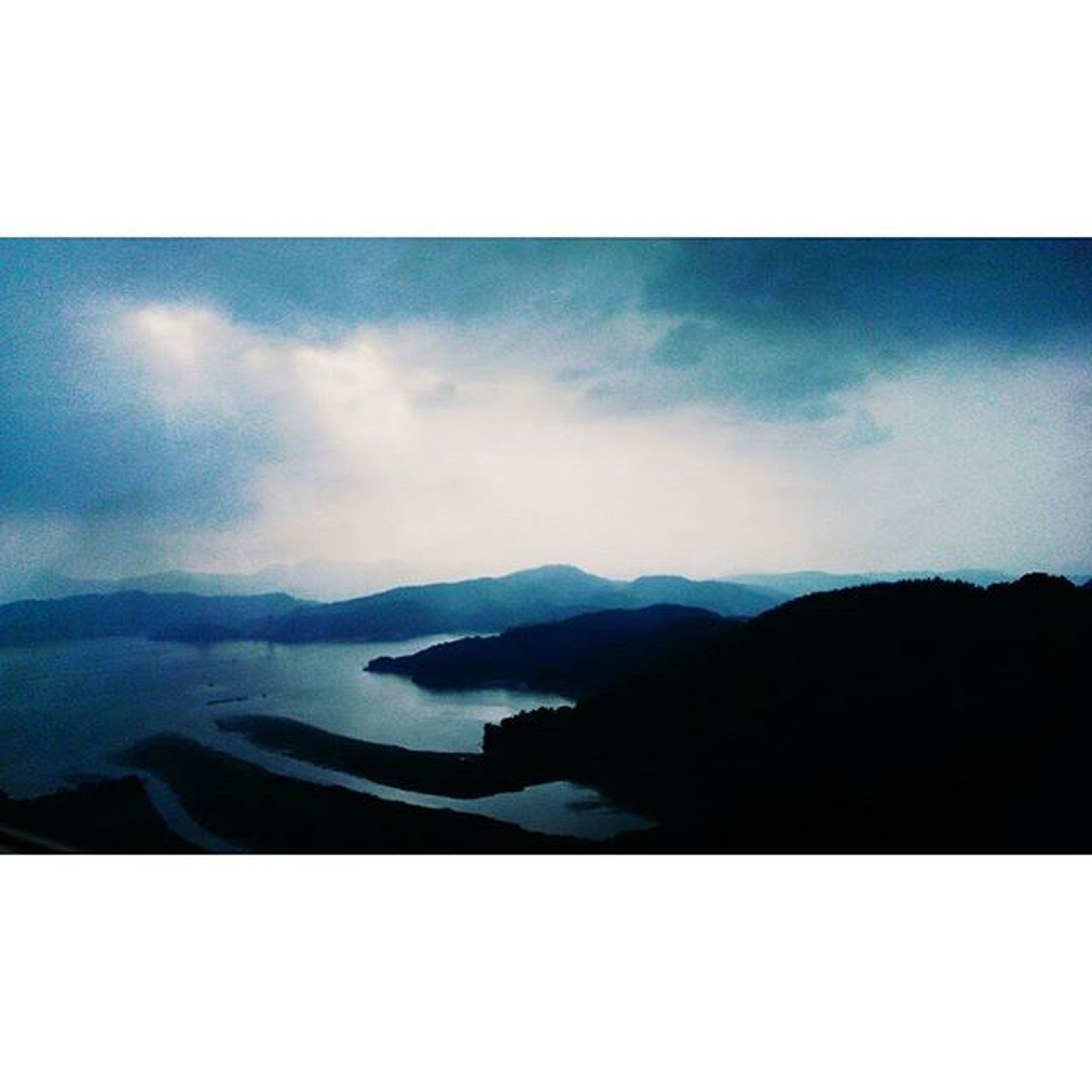 transfer print, auto post production filter, sky, mountain, scenics, tranquil scene, tranquility, beauty in nature, mountain range, silhouette, water, cloud - sky, nature, cloud, idyllic, dusk, sea, outdoors, lake, landscape