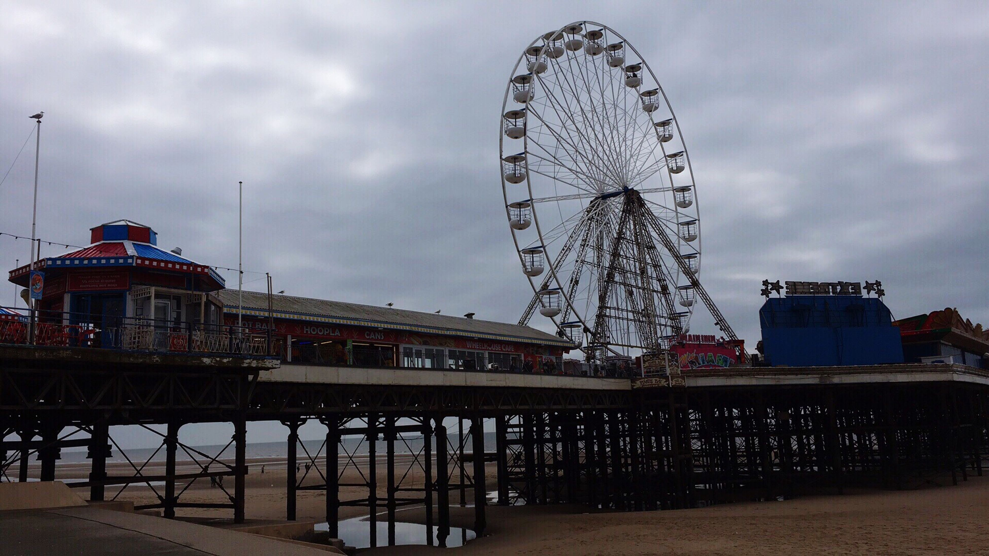 ferris wheel, amusement park, amusement park ride, arts culture and entertainment, architecture, sky, outdoors, no people, day