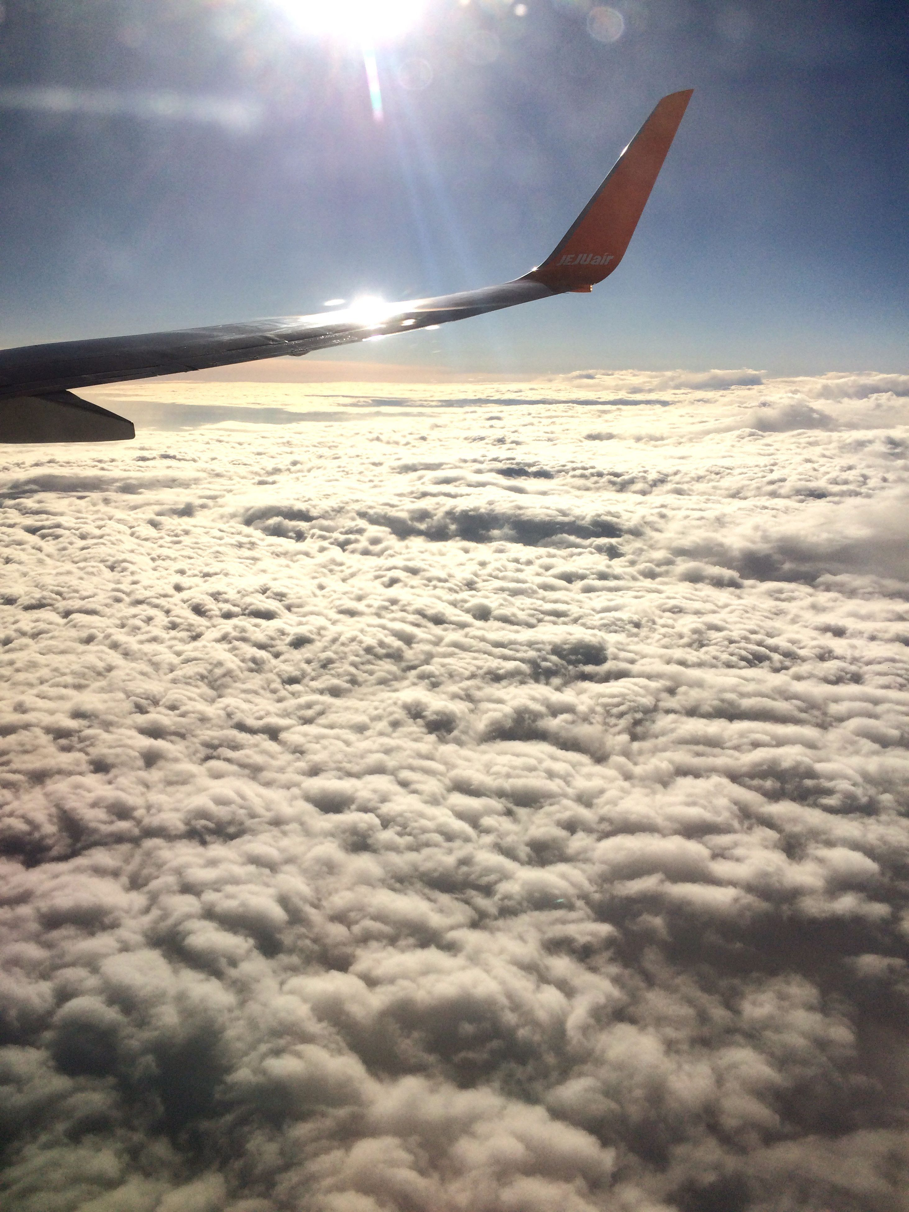 sky, sun, beauty in nature, scenics, tranquil scene, tranquility, flying, nature, sunlight, sunbeam, aircraft wing, cloud - sky, snow, airplane, landscape, transportation, cloud, idyllic, mid-air, blue