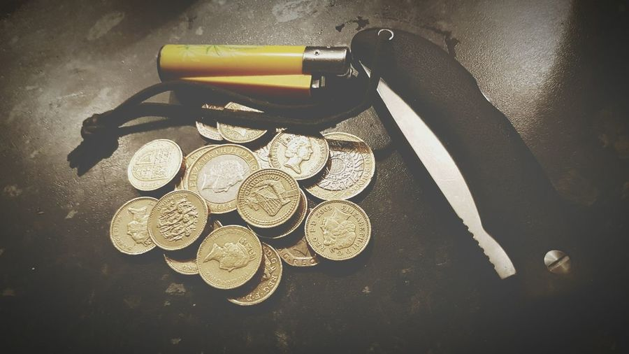 Large Group Of Objects No People Close-up Shrapnel Change Pound Coins Table Arrangement Pocket Knive Lighter Contents Of My Pocket