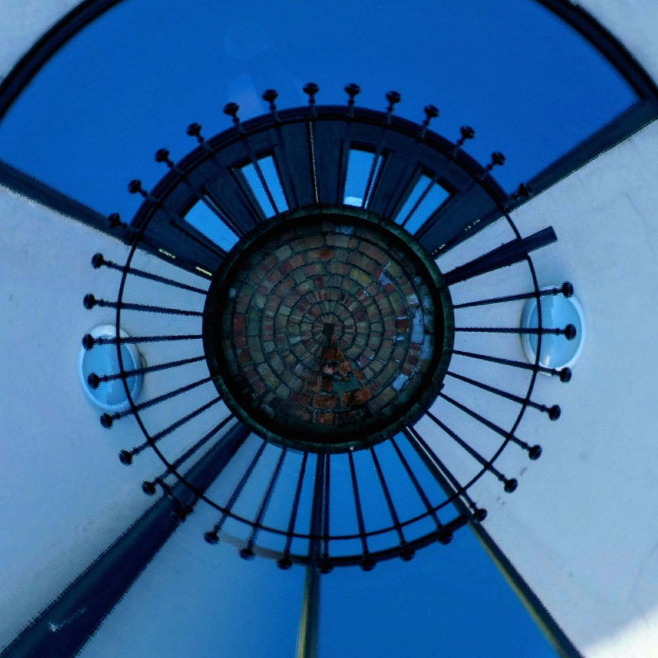 I've often had a go at a 'tiny planet' but not had much success But I really like the way these Railings have formed the clock effect Blue Sky Building Exterior Distorted Image Outdoors Day Patterns & Textures Showcase December Finding New Frontiers Sunny Day Tinyplanets Clockwise
