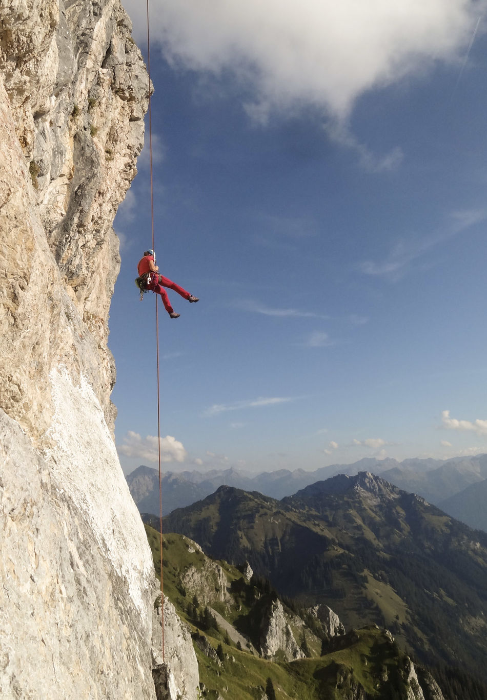 Adventure Alps Austria Beauty In Nature Climbing Extreme Sports Freedom Landscape Leisure Activity Lifestyles Mountain Mountain Peak Mountain Range Nature One Person Outdoors Rock - Object Rock Climbing Sky Sports Photography Woman Courage Wire