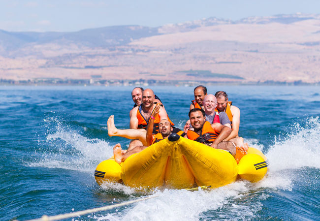 Tiberias, Israel, September 27, 2016: Group of young people floating on an inflatable attraction on Lake Kinneret in Tiberias, Israel Attraction Beautiful Boat Extreme Floating Group Happiness Happy Holiday Inflatable  Lake Leisure People Recreation  Relaxation Relaxing Sport Summer Sun Sunny Swimming Travel Vacation Water Young