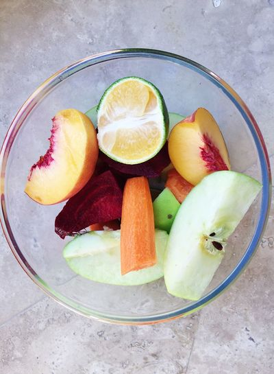 A bowl of freshly cut fruits and vegetables (apple, peach, mandarin, beetroot, carrot) ready for making fresh juice Apple Cooking Eating Food And Drink Juice Mandarine Vegetarian Food Vitamins Beetroot Carrot Eat Food Fresh Juice Freshness Fruits Healthy Healthy Eating Healthy Lifestyle Home Food Making Juice Peach Preparing Juice SLICE Vegetable Vegeterian