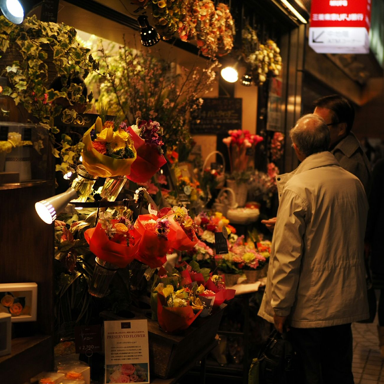 Men Capturing The Moment Night 50mm Snapshot Of Life Bokeh Photography Bokeh Bokehlicious Nightphotography Japan Photography Taking Photos Taking Pictures Flower Shop